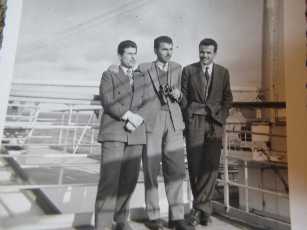 Three Greek immigrants gaze at the Atlantic Ocean  Three Greek immigrants gaze at the Atlantic Ocean from the ship's deck. Destination: Halifax Canada (1956). Source: Eleni Lampropoulos