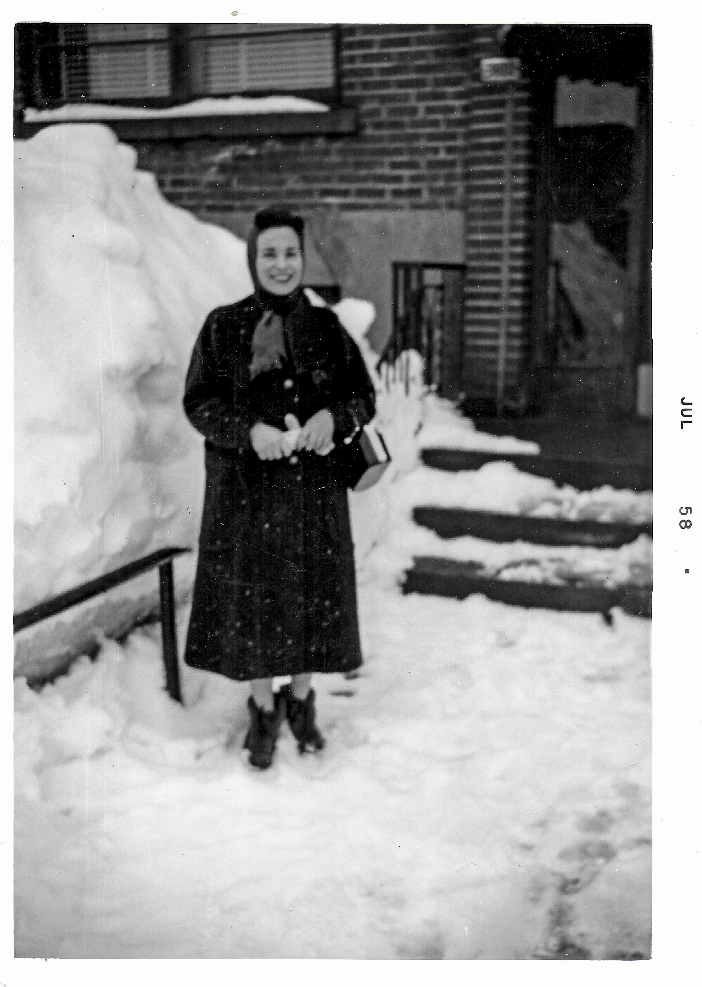 Winter of 1958 Woman posing in snowy landscape. Photo from the Aristea Vallianos archive. Source: Immigrec