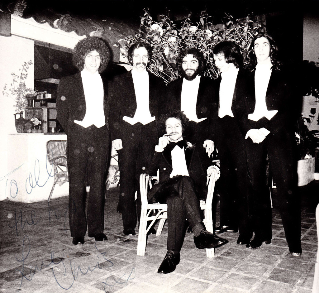 Memories of the workplace  'Kozmas' restaurant waiters and Christos Dikeakos (in the center, sitting) New Years Eve 1975.  Source: Immigrec
