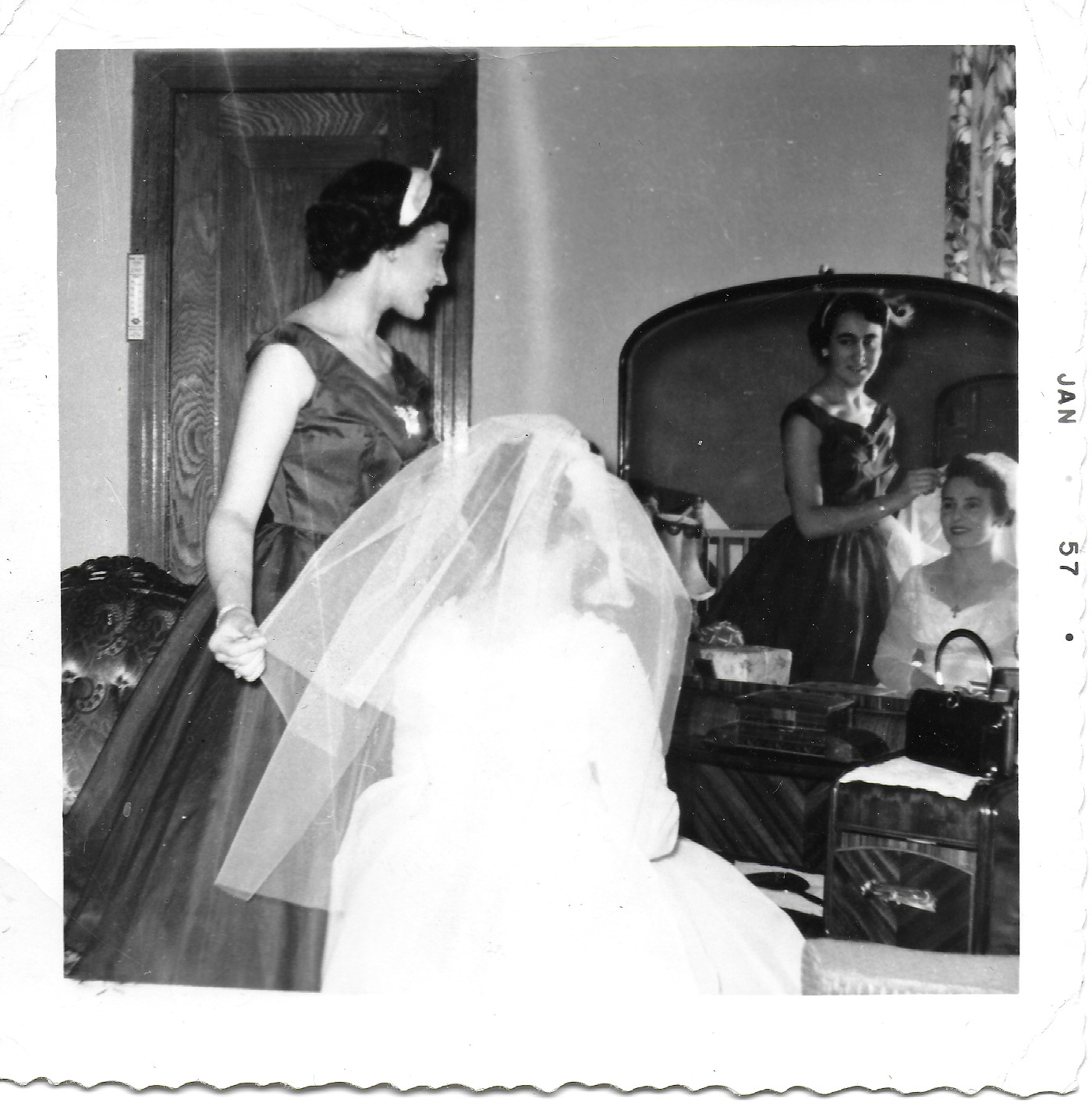 Bride preparations  Aliki Vallianos with her wedding dress, 1957. Montreal. Aristea's Vallianos Archive.  Source: Immigrec