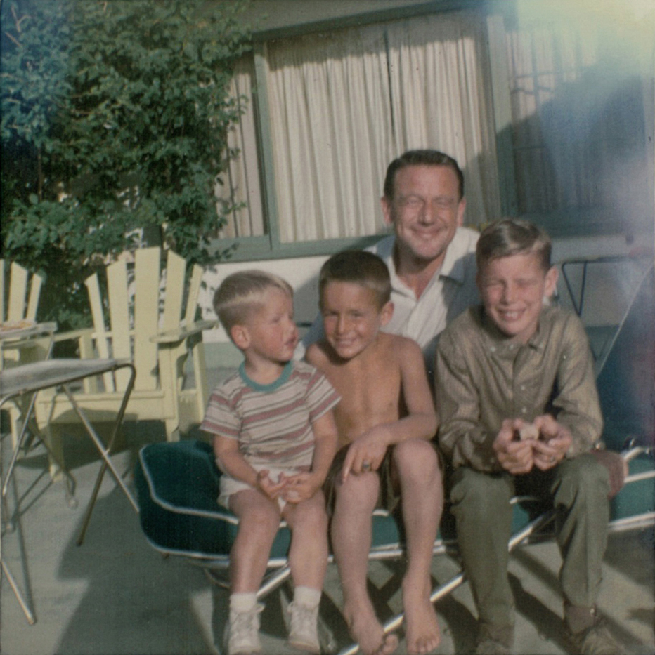 Family photographs  Man with his three children, Kelowna BC.  Source: Immigrec